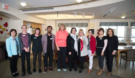 Elizabeth Manley poses with Alzheimer Society of Calgary Staff